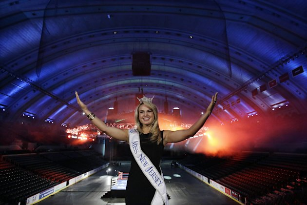 Miss New Jersey for 2012 in the Miss America pageant, Lindsey Petrosh, of Egg Harbor City, N.J., gestures for photographs in Atlantic City&#39;s Boardwalk Hall, Thursday, Feb. 14, 2013, in Atlantic City, after New Jersey Lt. Gov. Kim Guadagno announced that the Miss America pageant is returning to Atlantic City. The pageant returns to Atlantic City in September after spending six years in Las Vegas. (AP Photo/Mel Evans)