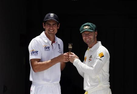 Australia's cricket team captain Clarke poses with England's team captain Cook in Brisbane