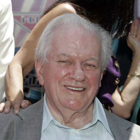 FILE - In this Thursday, July 31, 2008 file photo, actor Charles Durning smiles during ceremonies honoring him with a star on the Hollywood Walk of Fame in Los Angeles. Durning, the two-time Oscar nominee who was dubbed the king of the character actors for his skill in playing everything from a Nazi colonel to the pope, died Monday, Dec. 24, 2012 at his home in New York City. He was 89. (AP Photo/Reed Saxon)