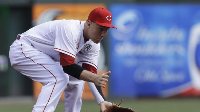 Cincinnati Reds third baseman Todd Frazier fields a ground ball hit by Los Angeles Angels' Albert Pujols in the first inning of an opening day baseball game, Monday, April 1, 2013, in Cincinnati. Frazier threw Pujols out at first. (AP Photo/Al Behrman)
