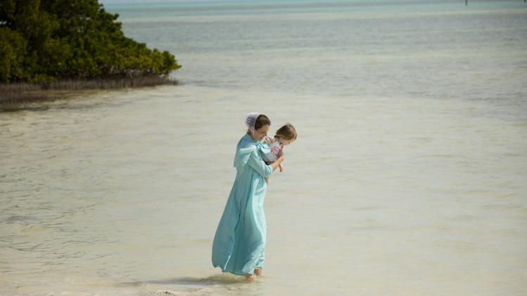 In this Feb. 12, 2013 photo, a visitor and her daughter wade in the waters of Anne's Beach near Islamorada, Fla.  The Florida Keys, spanning over 100 miles connected by bridges and causeways, offer plenty of activities at no cost. (AP Photo/J Pat Carter)