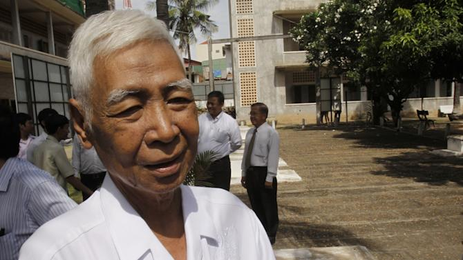 In this photo taken on Aug. 9, 2010, a Cambodian survivors, Vann Nath, 66, is seen at Tuol Sleng genocide museum, formerly Khmer Rouge's notorious S-21 prison in Phnom Penh, Cambodia. Nath lapsed into a coma in late August, 2011, after developing breathing difficulties, and his daughter Vann Chan Simen says he passed away on Monday, Sept. 5. (AP Photo/Heng Sinith)