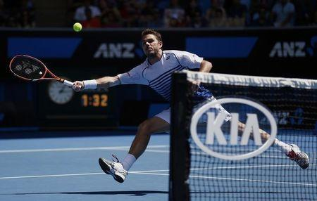 Wawrinka of Switzerland reaches to hit a return to Garcia-Lopez of Spain during their men's singles fourth round match at the Australian Open 2015 tennis tournament in Melbourne