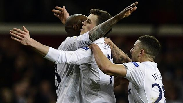 Gareth Bale of Tottenham Hotspur (C) celebrates his goal against Olympique Lyonnais with teammates William Gallas (L) and Kyle Walker during their Europa League soccer match at White Hart Lane in London February 14, 2013. REUTERS
