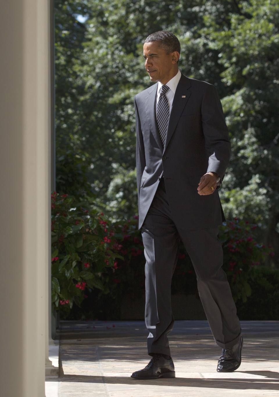 President Barack Obama walks to the Rose Garden of the White House in Washington, Wednesday, Aug. 31, 2011, to urge Congress to pass a federal highway bill. (AP Photo/Carolyn Kaster)