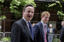 Britain&#039;s Prince Harry, right, and Prime Minister David Cameron arrive by New London Bus for the GREAT event, in New York, Tuesday, May 14, 2013. They are in New York to promote British trade and tourism. (AP Photo/Richard Drew)