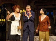 "In this theater image released by Boneau/Bryan-Brown, Jennifer Tilly, left, Ben Daniels, center, and Spencer Kayden are shown in a scene from the Roundabout Theatre Company's ""Don't Dress for Dinner,"" in New York. (AP Photo/Boneau/Bryan-Brown, Joan Marcus)"