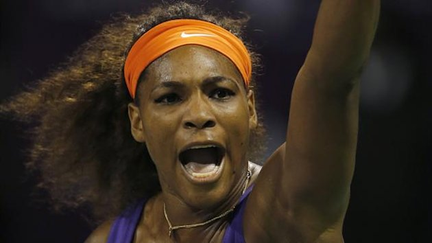 Serena Williams of the U.S. celebrates a point against Maria Sharapova of Russia during their women's semi-final match at the Qatar Open tennis tournament in Doha February 16, 2013. REUTERS