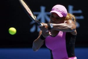 Serena Williams of the U.S. hits a return to Daniela Hantuchova of Slovakia during their women's singles matchat the Australian Open 2014 tennis tournament in Melbourne