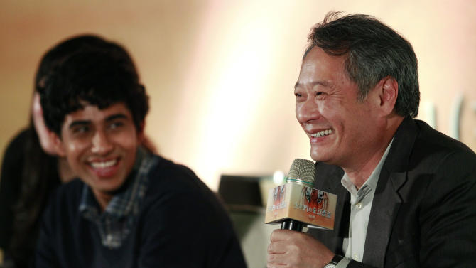 "Lead actor from India Suraj Sharma, left, looks on, as Taiwanese director Ang Lee answers questions during a press conference announcing their new film ""Life of Pi,"" in Taipei, Taiwan, Wednesday, Nov. 7, 2012. ""Life of Pi"" is an upcoming 3D adventure film based on the 2001 novel of the same name by Yann Martel, staring Sharma and directed by Lee. (AP Photo/Wally Santana)"