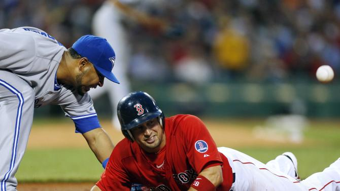 Toronto Blue Jays' Edwin Encarnacion, left, misses the ball after a throwing error by teammate Ramon Ortiz on a pickoff attempt at first base on Boston Red Sox's Shane Victorino, right, in the third inning of a baseball game in Boston, Friday, May 10, 2013. (AP Photo/Michael Dwyer)