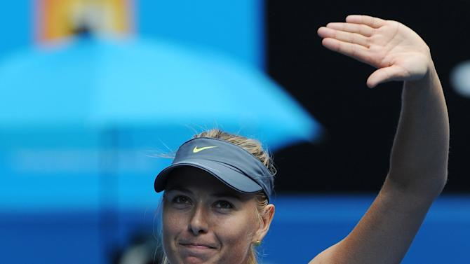 Russia's Maria Sharapova waves to the crowd following her win over compatriot Olga Puchkova in their first round match at the Australian Open tennis championship in Melbourne, Australia, Monday, Jan. 14, 2013. (AP Photo/Andrew Brownbill)