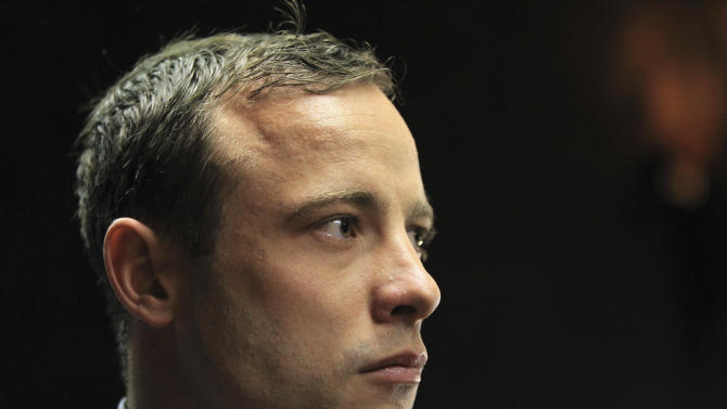 Double-amputee Olympian, Oscar Pistorius, looks on as he appears in the magistrates court in Pretoria, South Africa, Tuesday, June 4, 2013. Pistorius is back in the glare of public scrutiny for the first time in months when he appeared,  launching the next chapter of a sensational case that transformed the double-amputee Olympian from a smiling global inspiration to a sobbing suspect facing a life sentence in prison if convicted of killing his girlfriend. (AP Photo/Themba Hadebe)