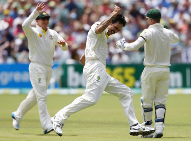 Australia's Johnson celebrates after taking the wicket of England's Prior during the third day's play in the second Ashes cricket test at the Adelaide Oval