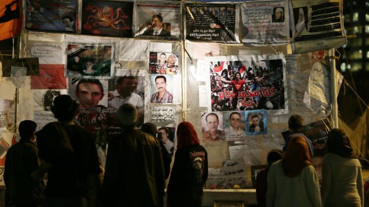 Egyptian protesters visit a makeshift museum in Tahrir Square, in Cairo, Egypt, Monday, Dec. 17, 2012. Egypt's political crisis shows no signs of abating as the opposition to the country's Islamist government levels new challenges against the legitimacy of a referendum on a draft constitution. Morsi also confronts criticism from the judiciary, as prosecutors hold a sit-in to demand removal of a new prosecutor general he appointed. (AP Photo/Hassan Ammar)