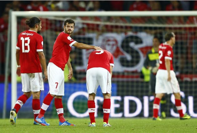 Switzerland's Barnetta comforts his teammate von Bergen after their 2014 World Cup qualifying soccer match against Iceland in Bern