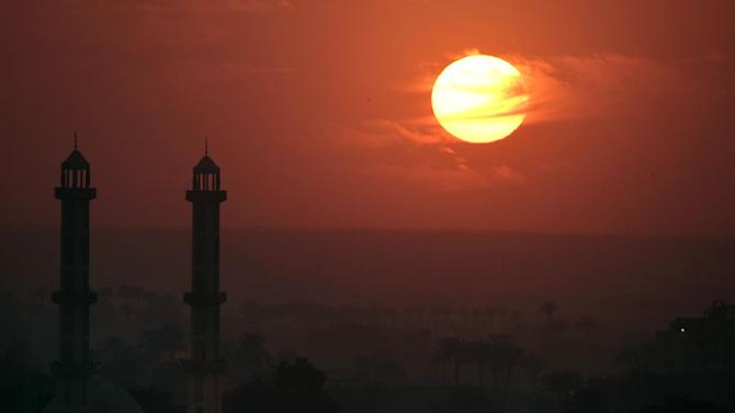 A Mousque silhouetted against sunset in Cairo, Egypt, Monday, Dec. 31, 2012. (AP Photo/Amr Nabil)