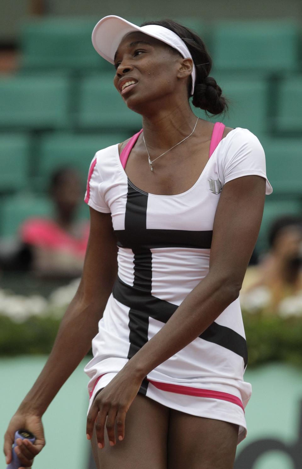 USA's Venus Williams reacts as she plays Poland's Agnieszka Radwanska  during their second round match in the French Open tennis tournament at the Roland Garros stadium in Paris, Wednesday, May 30, 2012.  (AP Photo/Michel Spingler)