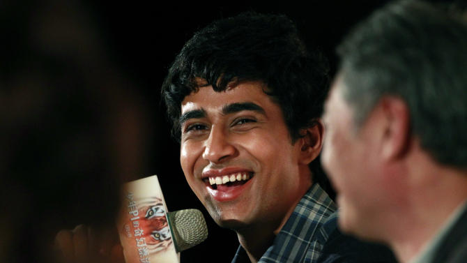 """Lead actor from India Suraj Sharma answers questions about director Ang Lee during a press conference announcing their new film """"Life of Pi,"""" in Taipei, Taiwan, Wednesday, Nov. 7, 2012. """"Life of Pi"""" is an upcoming 3D adventure film based on the 2001 novel of the same name by Yann Martel, staring Sharma and directed by Lee. (AP Photo/Wally Santana)"""