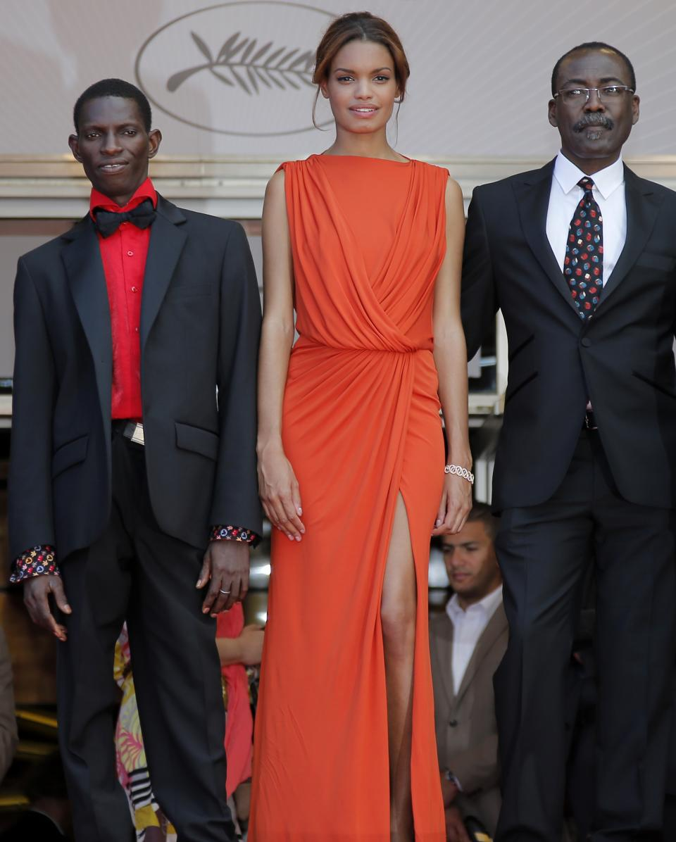 From left, actor Souleymane Deme, actress Anais Monory and director Mahamat-Saleh Haroun arrive for the screening of Grigris at the 66th international film festival, in Cannes, southern France, Wednesday, May 22, 2013. (AP Photo/Lionel Cironneau)