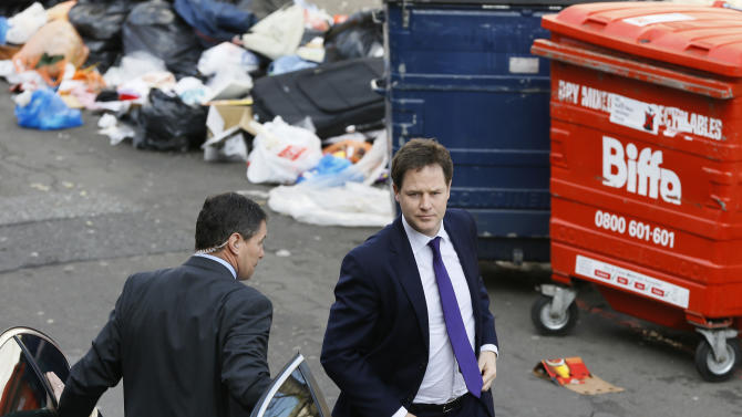 Britain's Deputy Prime Minister Nick Clegg, right, arrives in Brixton in London, Thursday, April 25, 2013. The Deputy Prime Minister visited a housing estate in Brixton with Jeremy Browne, Minister for Crime Prevention, to meet with police and community workers to see how crime is being tackled in the area. (AP Photo/Kirsty Wigglesworth, pool)