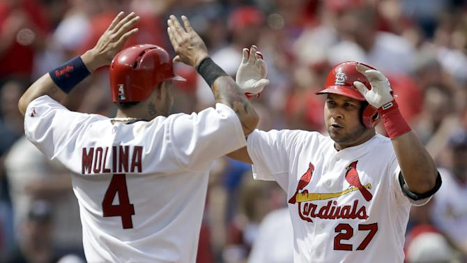 Wainwright, Peralta pace Cardinals past Pirates