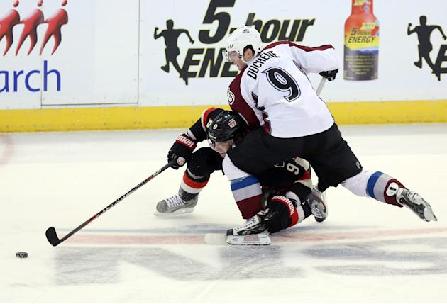 Colorado Avalanche's Matt Duchene (9) checks Ottawa Senators' Milan Michalek during third-period NHL hockey game action in Ottawa, Ontario, Sunday, March 16, 2014