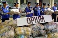 Myanmar police display confiscated packets of opium in Yangon. Myanmar authorities warned Wednesday that it was facing a deepening drug crisis after seizing narcotics including more than 1.4 million amphetamine pills and 116 kilos of heroin in July