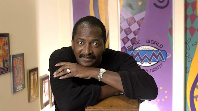 "FILE - In this Dec. 8, 2003 file photo, Mathew Knowles, father and former manager of singer Beyonce Knowles, poses at his Music World Entertainment headquarters in Houston. Knowles has launched a reality show searching for an all-girl group, ""Breaking from Above.""  The program will air on MTV channels outside of the U.S. (AP Photo/David J. Phillip, file)"