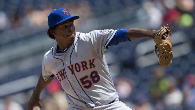 New York Mets starting pitcher Jenrry Mejia delivers a pitch during the first inning of a baseball game against the Washington Nationals at Nationals Park on Friday, July 26, 2013, in Washington. (AP Photo/Evan Vucci)