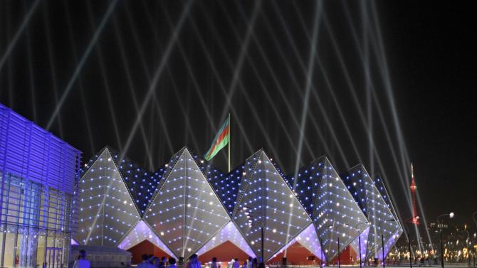 The Baku Crystal Palace is lit by lights during the rehearsals for the 2012 Eurovision Song contest in Baku, Tuesday, May 22, 2012. The capital of this former Soviet republic has shed its dour, industrial image and evolved into a vibrant metropolis combining the old world charms of Istanbul with the architectural ostentations of Dubai. Now it has the perfect stage to show off its decade-long transformation: the Eurovision Song contest. (AP Photo/Sergey Ponomarev)