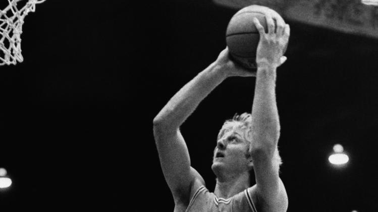 FILE - This Dec. 2, 1978 file photo shows Indiana State University basketball player  Larry Bird (33) going up to score over University of Evansville's  Barry Weston (40) in Evansville, Ind. The Indiana Pacers have parted ways with Bird. The 55-year-old Bird was the Pacers coach from 1997-2000, taking the team to its only NBA Finals appearance that final year, before returning to the front office in 2003.  (AP Photo/File)