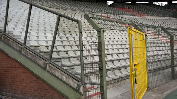 A metal cage surrounds a supporter section at the King Boudouin (formerly the Heysel) Stadium in Brussels on Friday, May 29, 2015. Friday marks 30 years since 39 victims lost their lives during a European Cup football match between Liverpool and Juventus due to a surge of rival supporters resulting in a collapsed wall. (AP Photo/Virginia Mayo)