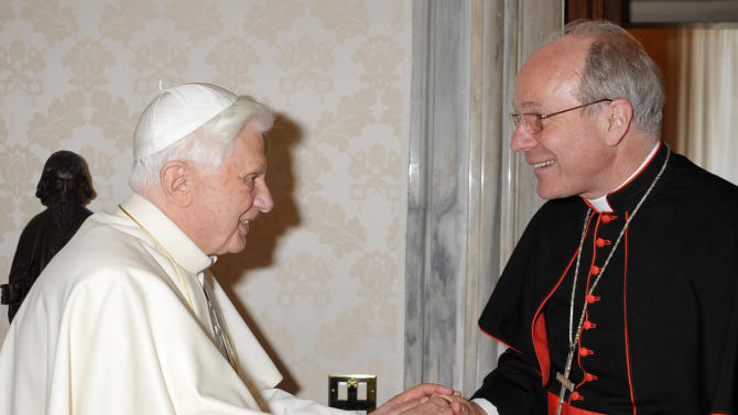 "FILE -- In this file picture taken at the Vatican on June 28, 2010 and made available by the Vatican newspaper Osservatore Romano, Pope Benedict XVI, left, shakes hands with Vienna's archbishop, Cardinal Christoph Schoenborn during their private meeting. Multilingual and respected by Jews, Muslims and Orthodox Christian, Benedict XVI's friend and former pupil was one of the cardinal electors in the 2005 papal conclave that chose the German as head of the Catholic church. A scholar who is at home in the pulpit, Schoenborn also is well connected in the Vatican _ and appears willing to make it his home, if reluctantly. Asked if he would like to succeed Benedict on news of the pontiff's plan to step down, he said: ""my heart is in Vienna, my heart is in Austria _ but naturally with the whole Church as well.""  (AP Photo/Osservatore Romano, HO)"