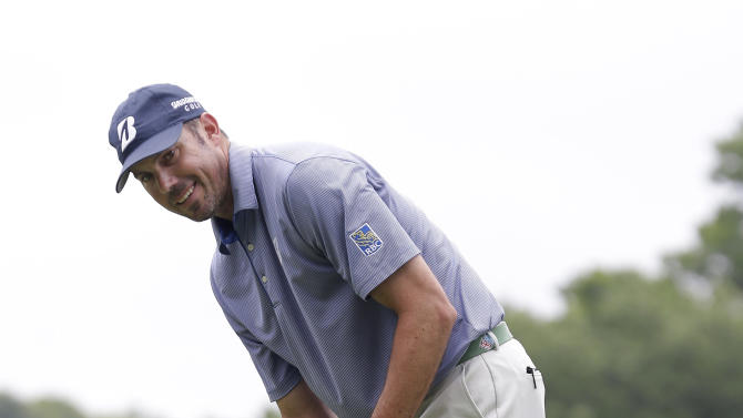 Matt Kuchar smiles after just missing a putt on the second hole during the third round of the Colonial golf tournament Saturday, May 25, 2013, in Fort Worth, Texas.  (AP Photo/LM Otero)