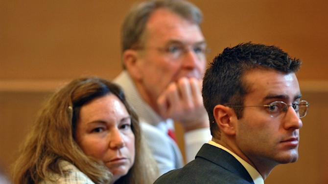 """FILE - In this July 10, 2006 file photo, Christopher Porco, right, and his attorneys Terence Kindlon, left, and Laurie Shanks, center, are shown during his trial in the Orange County Courthouse in Goshen, N.Y. A New York judge has temporarily barred Lifetime from showing its made-for-TV movie on Porco, a man from upstate New York convicted in the 2004 axe murder of his father and maiming of his mother. Lifetime has scheduled """"Romeo Killer: The Christopher Porco Story"""" to debut on Saturday night and repeat on Sunday. (AP Photo/Philip Kamrass, Pool, File)"""