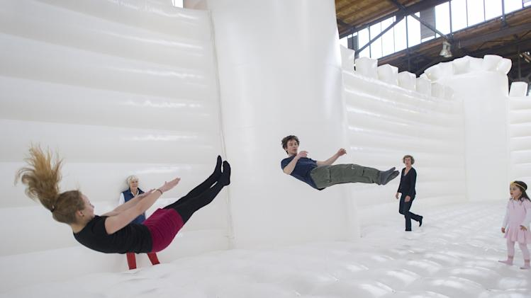 """White Bouncy Castle"" Art Installation Lures Visitors To Dance"