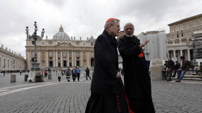 German Cardinal Walter Kasper, left, shares a word with Indian Cardinal George Alencherry in St. Peter's Square following a cardinals' meeting, at the Vatican, Thursday, March 7, 2013. Cardinals from around the world are gathered inside the Vatican on the fourth day of meetings before the conclave to elect the next pope, amid scandals inside and out of the Vatican and the continued reverberations of Benedict XVI's decision to retire. (AP Photo/Alessandra Tarantino)