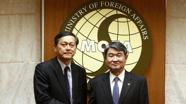 Akitaka Saiki, Japan's Vice Minister for Foreign Affairs, shakes hands with South Korean counterpart Cho Tae-yong before meeting at foreign ministry in Seoul