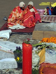Indian activists keep warm with blankets during a protest in New Delhi on January 8, 2013, against the gang rape and murder of a student. Two of the five men accused of gang-raping and murdering a 23-year-old woman in a moving bus in New Delhi last month will plead not guilty to all charges, a lawyer said Tuesday
