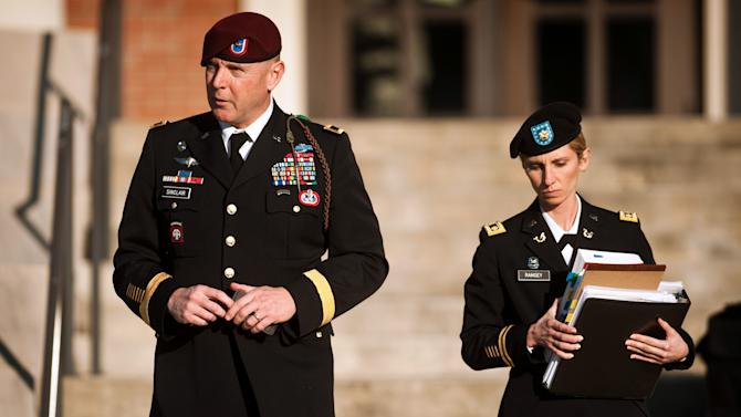 Army Brig. Gen. Jeffrey A. Sinclair, left, leaves a Fort Bragg courthouse with a member of his defense team, Maj. Elizabeth Ramsey, Tuesday, Jan. 22, 2012, after he deferred entering a plea at his arraignment on charges of fraud, forcible sodomy, coercion and inappropriate relationships.  Sinclair, who served five combat tours, is headed to trial following a spate of highly publicized military sex scandals involving high-ranking officers that has triggered a review of ethics training across the service branches.    (AP Photo/The Fayetteville Observer, Andrew Craft)