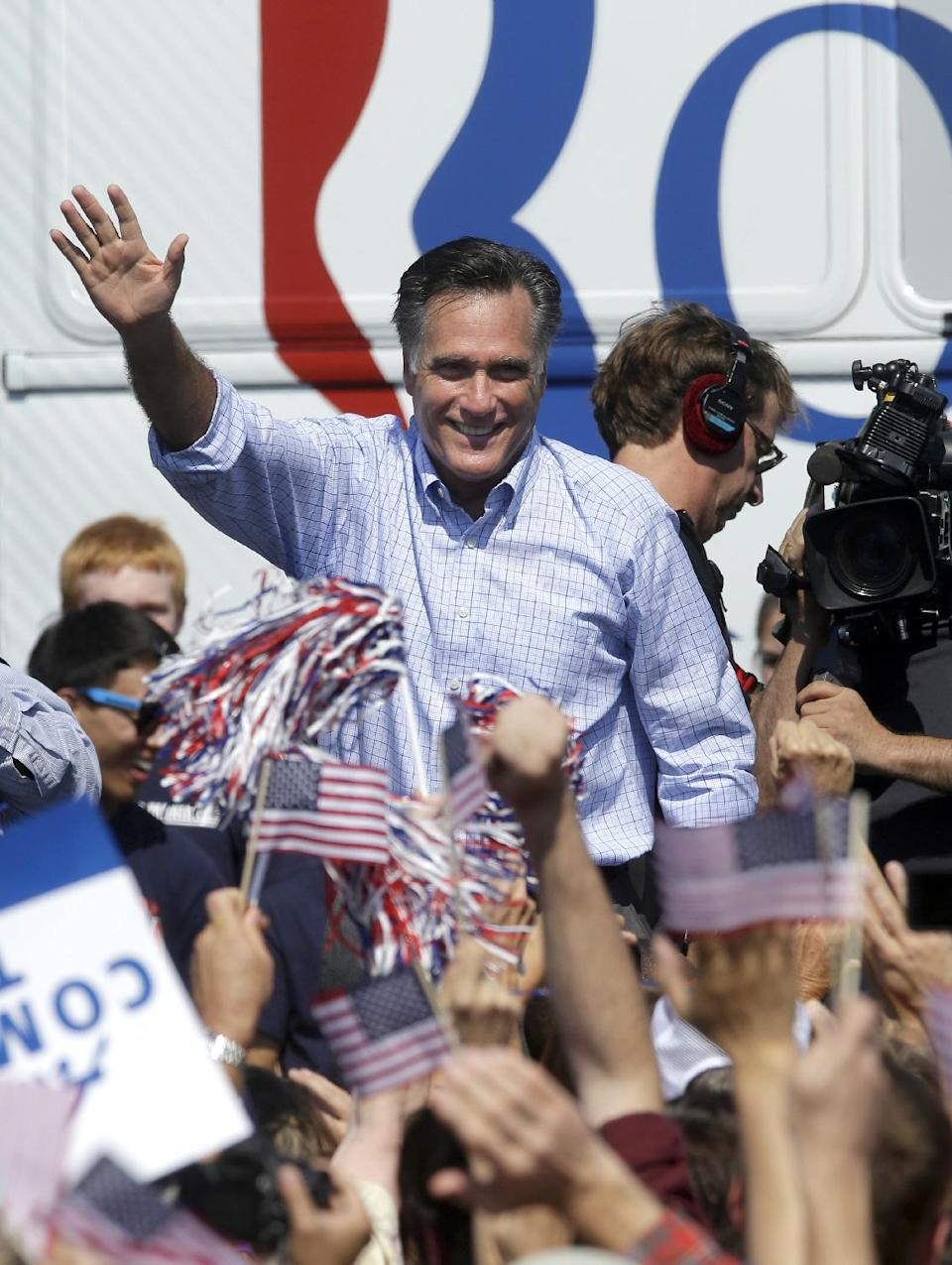 Republican presidential candidate, former Massachusetts Gov. Mitt Romney waves to supporters during a campaign event at Van Dyck Park, Thursday, Sept. 13, 2012, in Fairfax, Va. (AP Photo/Pablo Martinez Monsivais)
