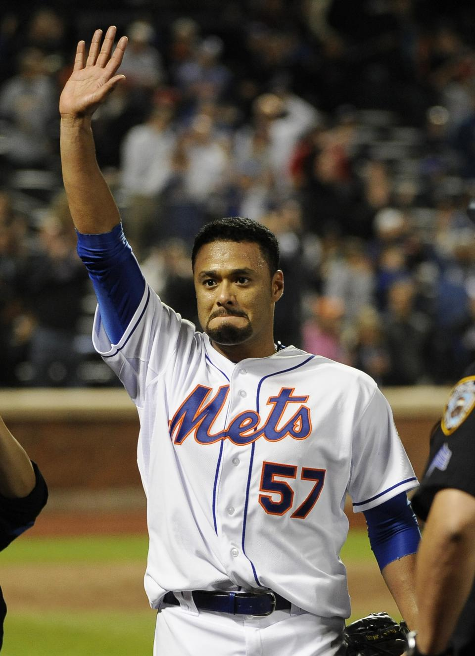 New York Mets starting pitcher Johan Santana (57) waves to fans after throwing a no-hitter against the St. Louis Cardinals in a baseball game on Friday, June 1, 2012, at Citi Field in New York. The Mets won 8-0. (AP Photo/Kathy Kmonicek)