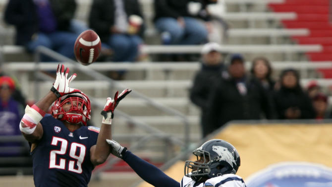 Arizona's Austin Hill catches a 63-yard pass for a touch own in front of Nevada's C.J. Dozier during the second half of the New Mexico Bowl NCAA college football game in Albuquerque, N.M., Saturday, Dec. 15, 2012. (AP Photo/Eric Draper)