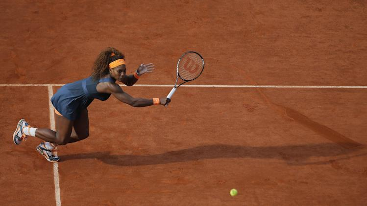 Serena Williams of the U.S. returns against Italy's Sara Errani in their semifinal match at the French Open tennis tournament, at Roland Garros stadium in Paris, Thursday June 6, 2013. Williams won in two sets 6-0, 6-1. (AP Photo/Michel Spingler)
