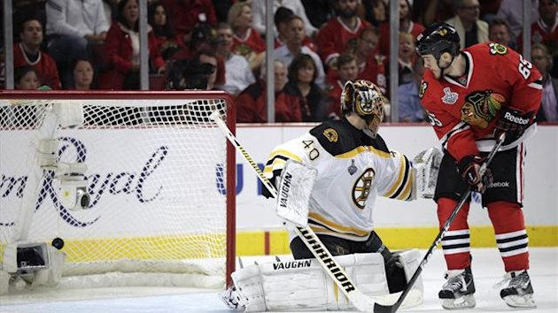 Chicago Blackhawks' Andrew Shaw (65) scores the game-winning goal past Boston Bruins goalie Tuukka Rask during triple overtime in Game 1 of their NHL Stanley Cup Finals hockey game