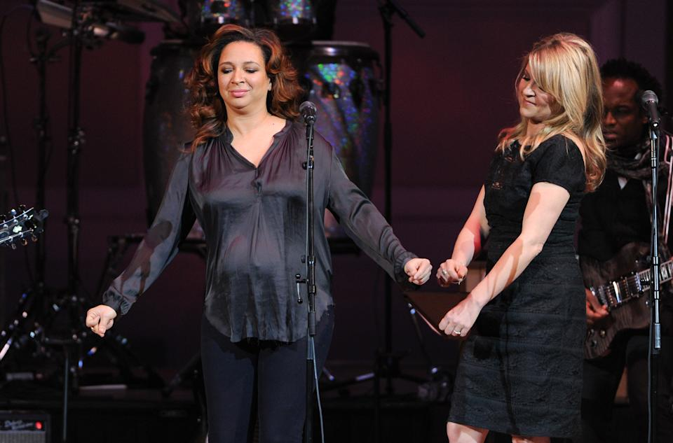 "Actress Maya Rudolph, left and singer Gretchen Lieberum perform at ""The Music of Prince"" tribute concert at Carnegie Hall on Thursday March 7, 2013 in New York. (Photo by Evan Agostini/Invision/AP)"