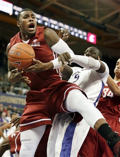 Huskies pull away from Cougars for 72-68 victory