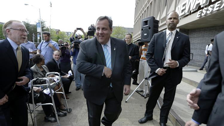 New Jersey Gov. Chris Christie walks to a podium during the groundbreaking ceremony for the Technology Enhanced Accelerated Learning Center at Essex County Newark Tech, Tuesday, May 7, 2013, in Newark, N.J. Reports say Christie secretly underwent a weight-loss surgery in February, when a band was placed around his stomach to restrict the amount of food he can eat. (AP Photo/Julio Cortez)
