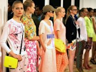 Models present the J.Crew women&#39;s wear collection on September 11 during New York fashion week. J.Crew embraced a rainbow of candy colors for a fresh range of youthful looks for men and women, many shown with models in geeky glasses